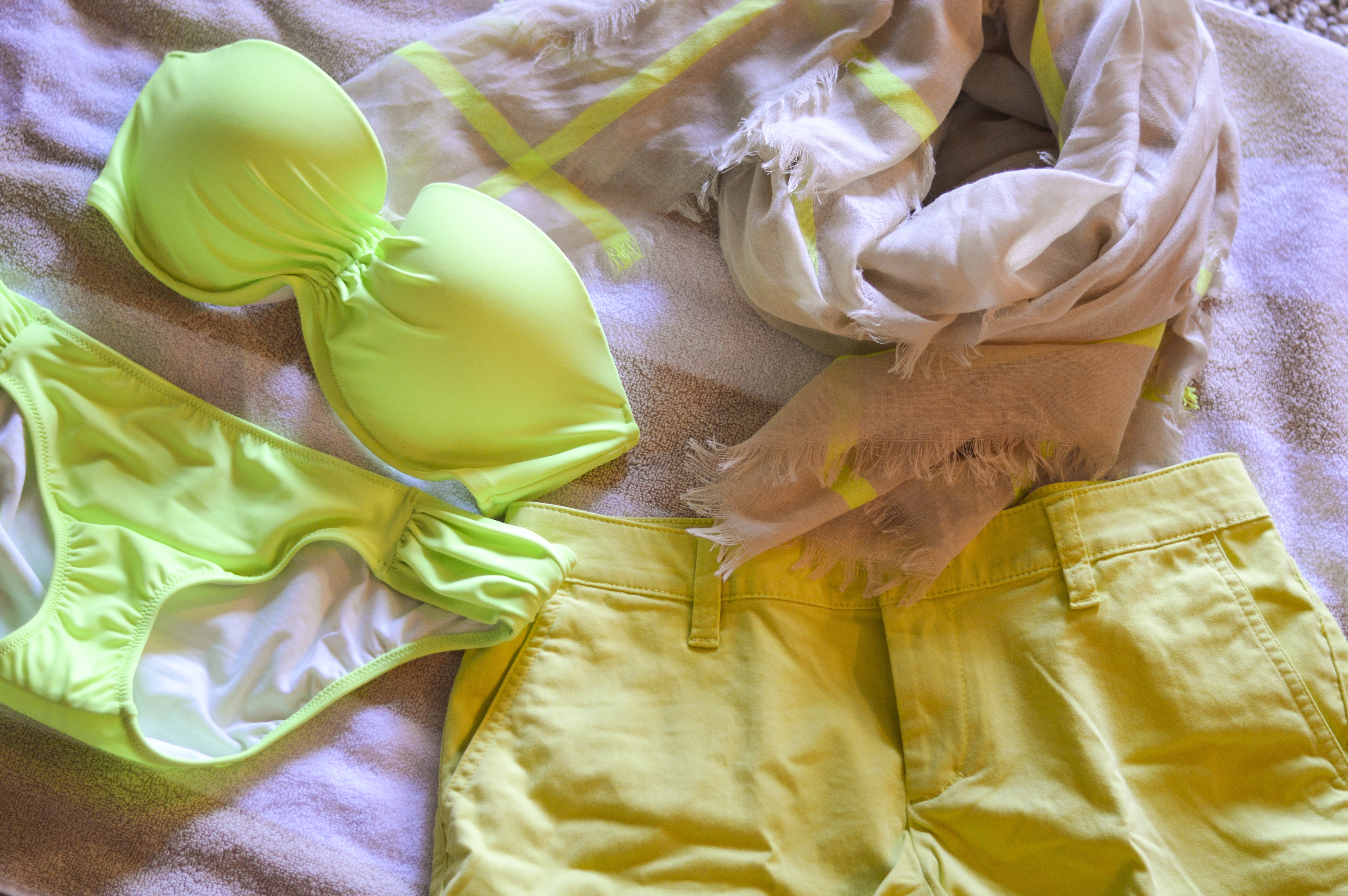 lime color swim suit and shorts