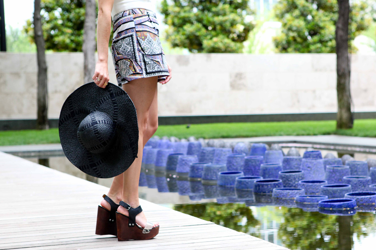 printed shorts with black floppy hat