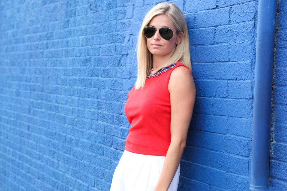 red beaded top with white shorts