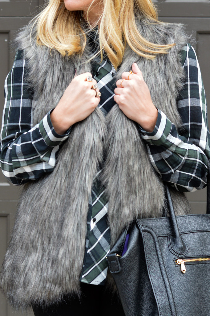 grey fur vest and plaid