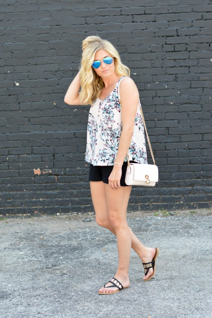 pink floral trapeze top with black shorts