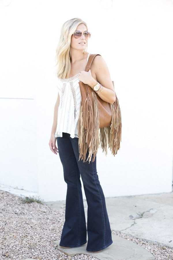 tan fringe satchel-dark flare jeans-white stripe tank