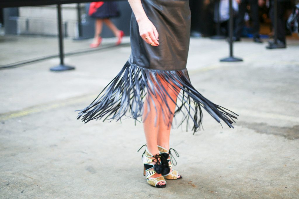 black fringe skirt-faux leather fringe skirt-zebra lace up heels-pom pom heels