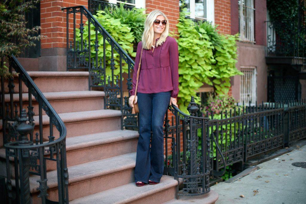 long sleeve burgundy blouse-dark flare jeans-camel crossbody purse-how to wear burgundy for fall