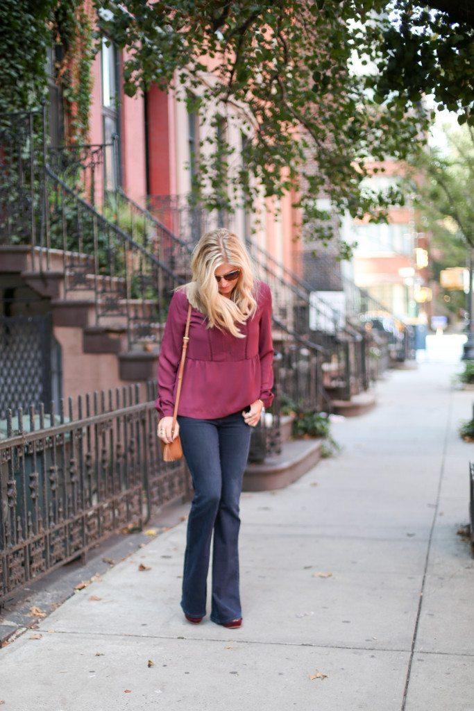 burgundy pintuck long sleeve blouse-gigi new york crossbody with fringe tassel-high rise flare jeans-fashion blogger dallas-fall color trends
