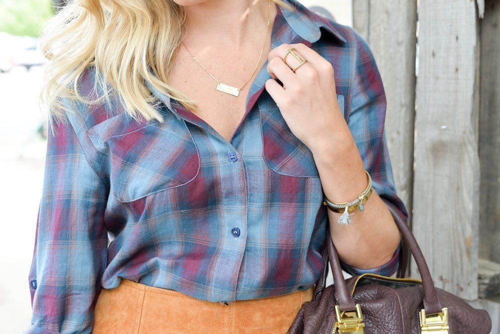 blue plaid shirt-gold bar necklace-gold tassel bracelet