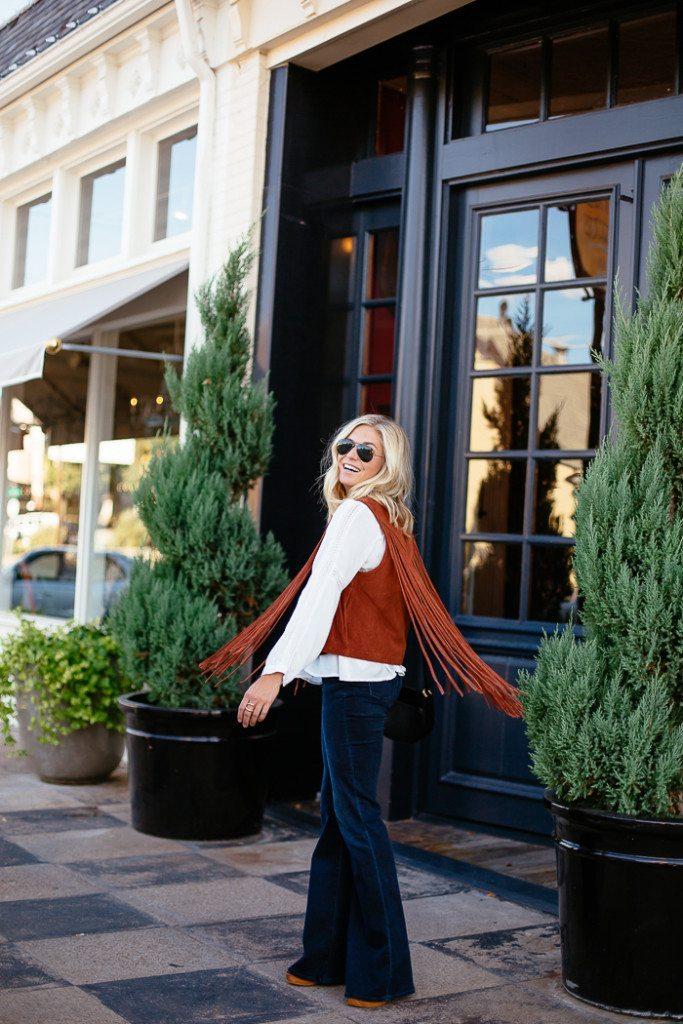 tan suede fringe vest-white peasant blouse-dark denim flare jeans-fashion blogger dallas