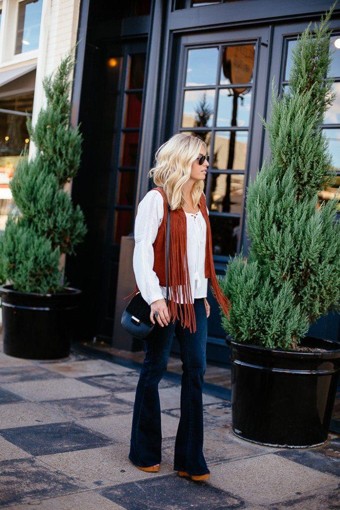 suede vest with fringe-peasant blouse-black saddle bag-high rise flare jeans-dallas fashion blogger