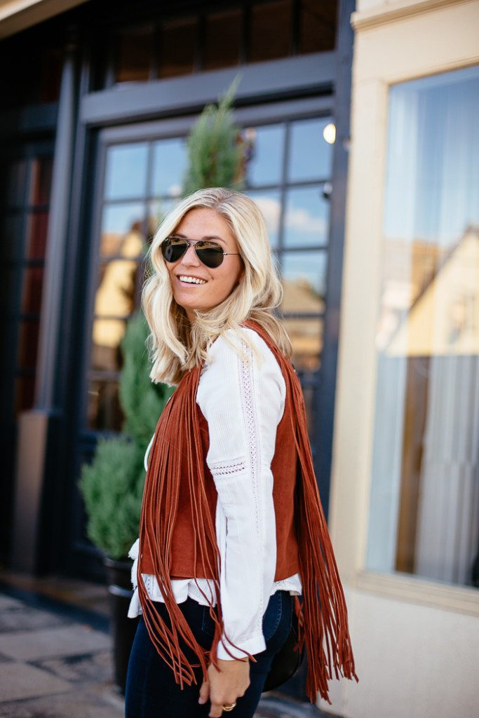 topshop fringe vest-white long sleeve blouse-black aviator sunglasses