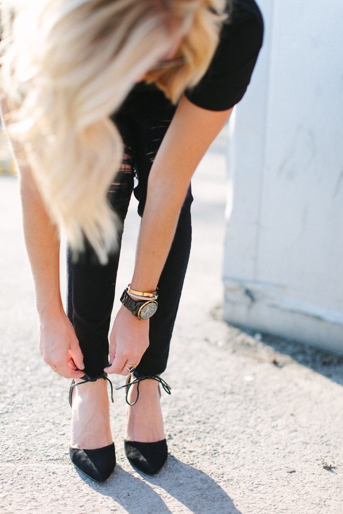 black ankle strap pointed toe heels and black skinny jeans