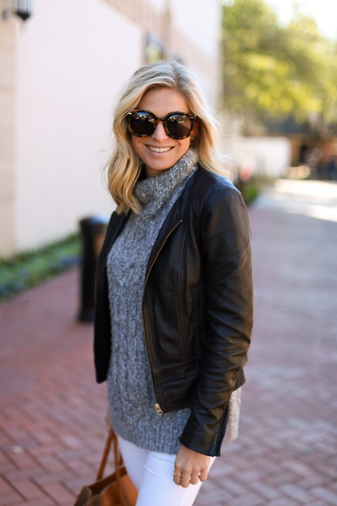 grey sweater with black leather jacket