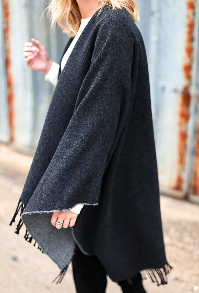 reversible fringe cape in multiple color combinations