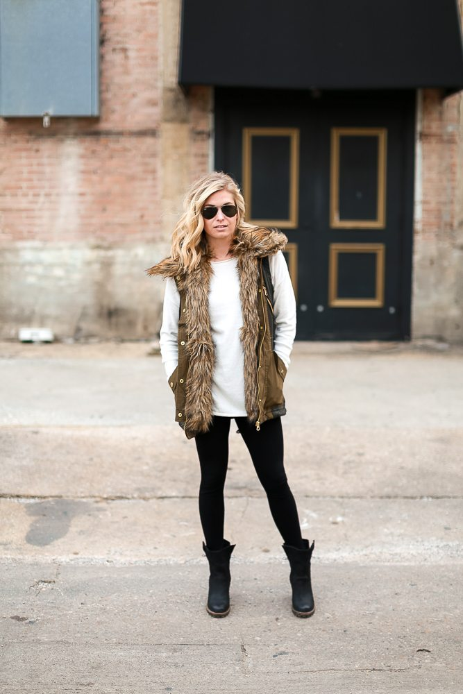 winter outfit inspiration-army green vest with faux fur collar-simple white sweater-basic black leggings-black leather combat booties-dallas fashion blogger