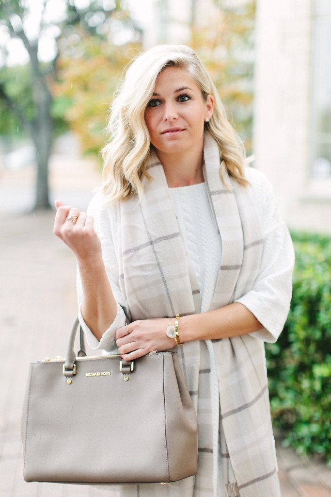 white cable knit tunic with neutral plaid scarf