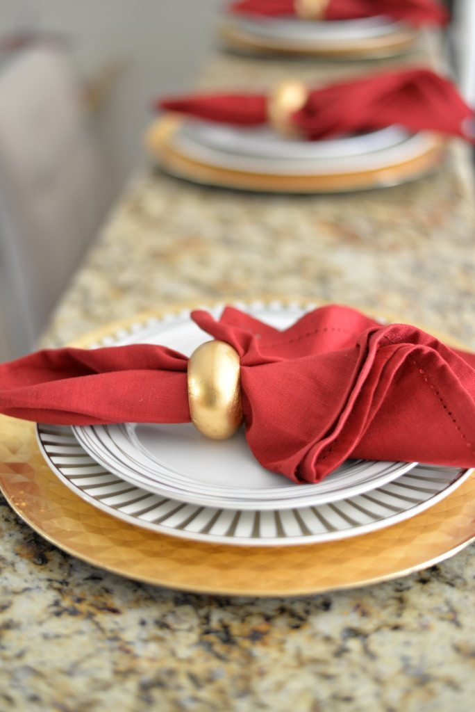 red and gold holiday place setting