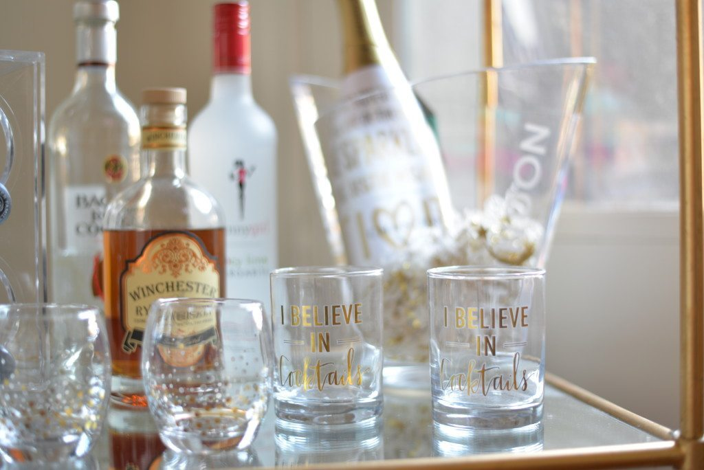 cocktail glasses on gold bar cart