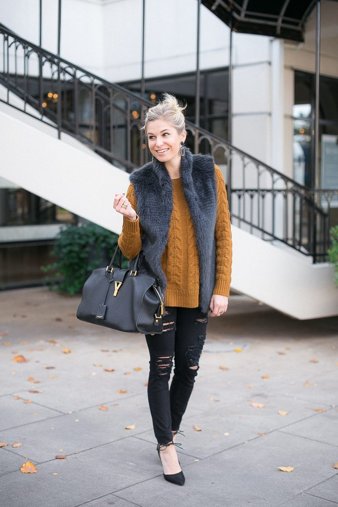 new years eve outfit-ripped black jeans-cable knit sweater with fur vest