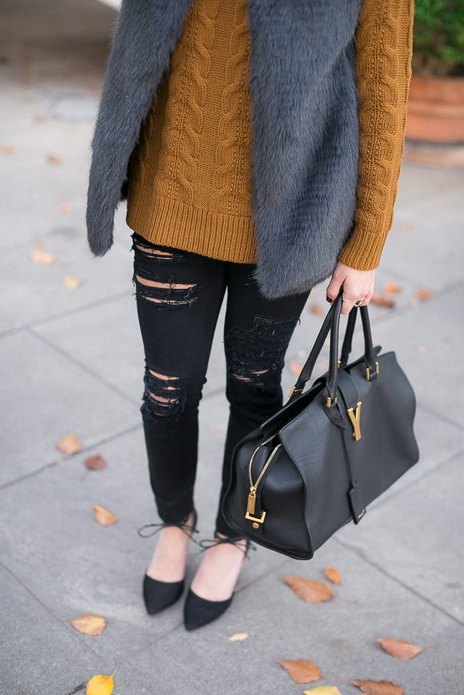 black ripped jeans-black handbag-casual new years eve outfit