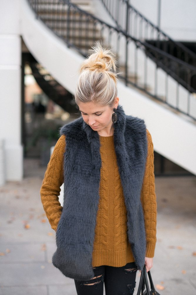 gold cable knit sweater-faux fur vest-casual new years eve outfit
