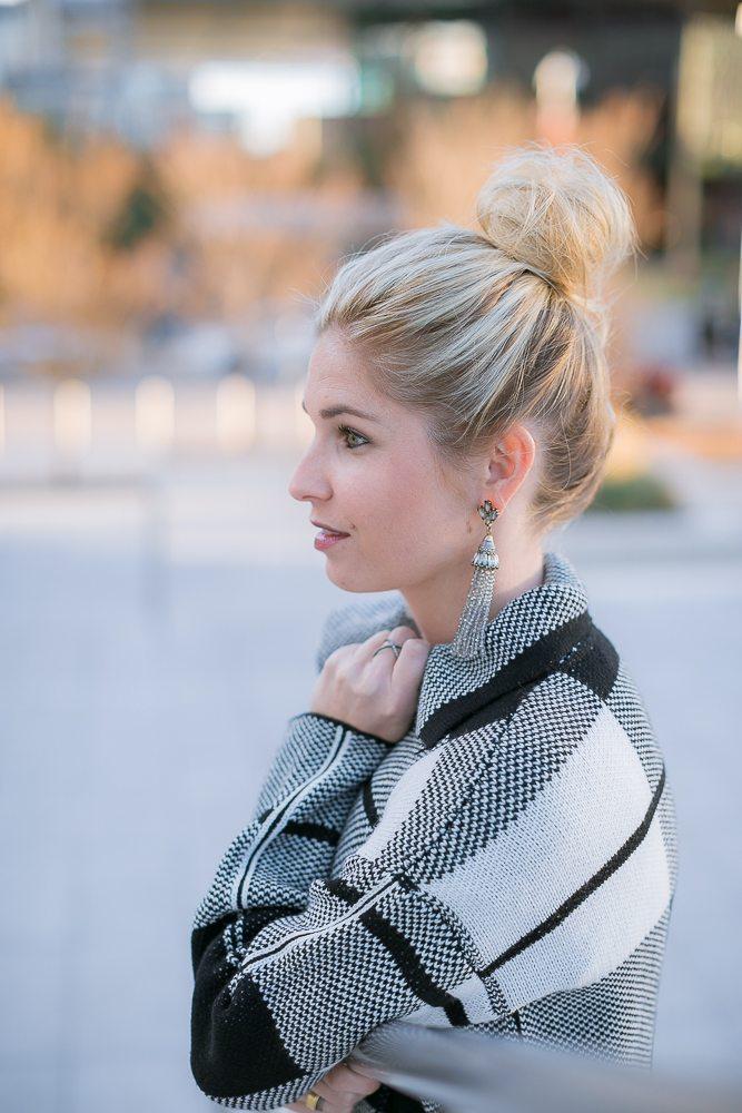 baublebar gray tassel drop earrings with hair up in messy bun