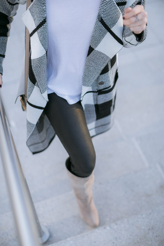 black coated skinny jeans-black and white sweater cardigan-winter outfit inspiration