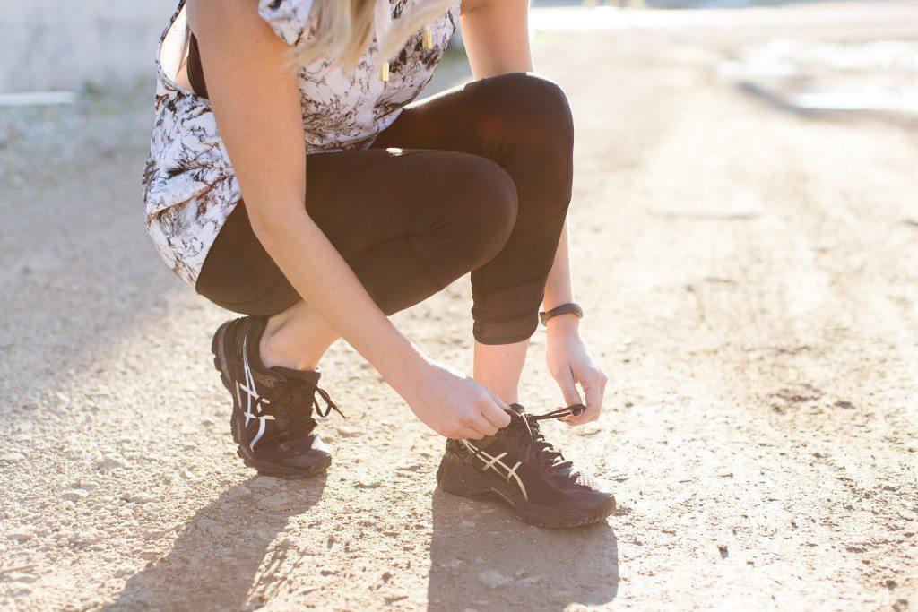 black asic running shoes
