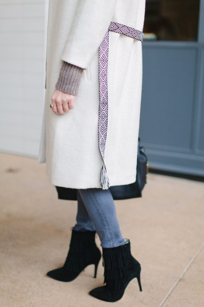winter white coat with black pattern belt