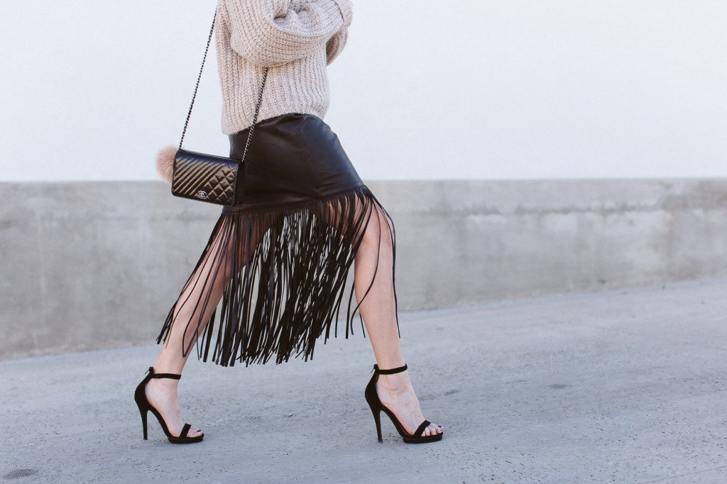 black faux lather fringe skirt