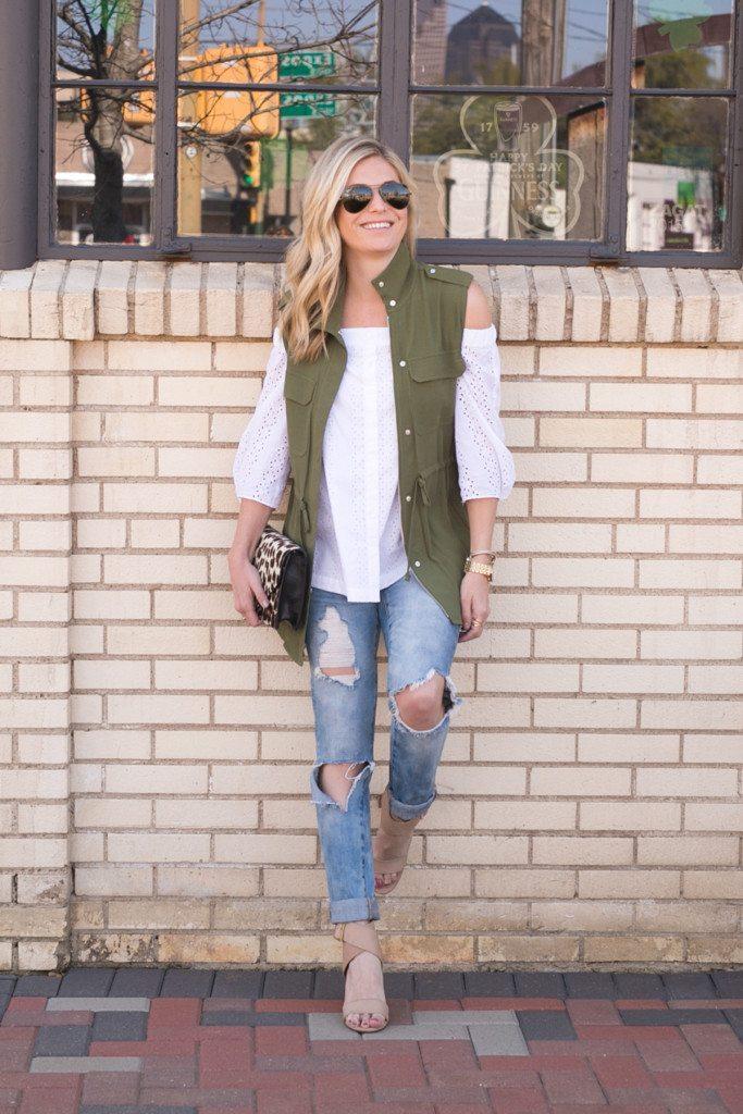 military vest-white off the shoulder shirt-destroyed skinny jeans