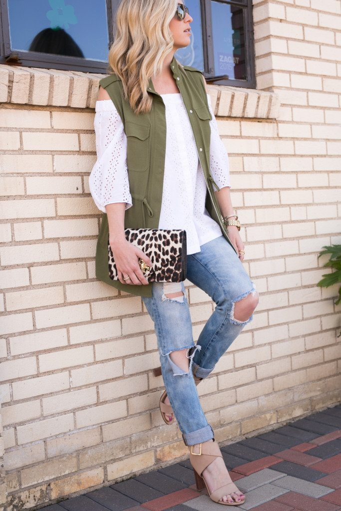 army green military vest-ripped skinny jeans-leopard clutch-st pattys day