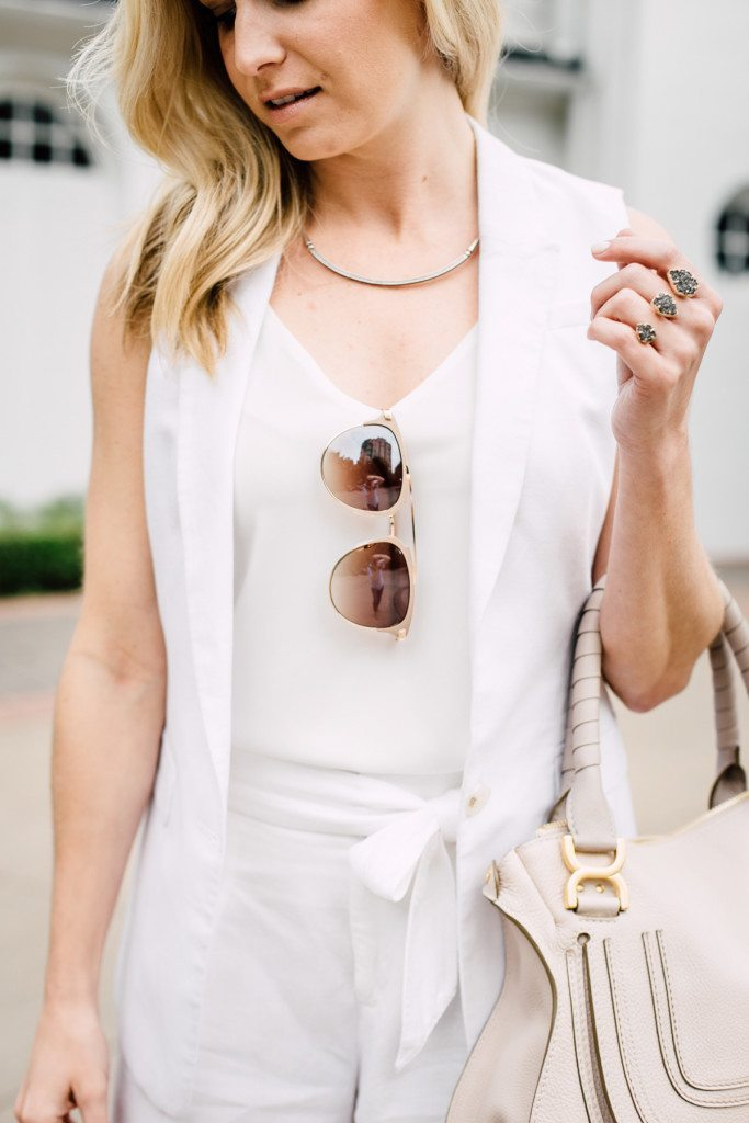 white linen sleeveless vest with white tank and dior sunglasses