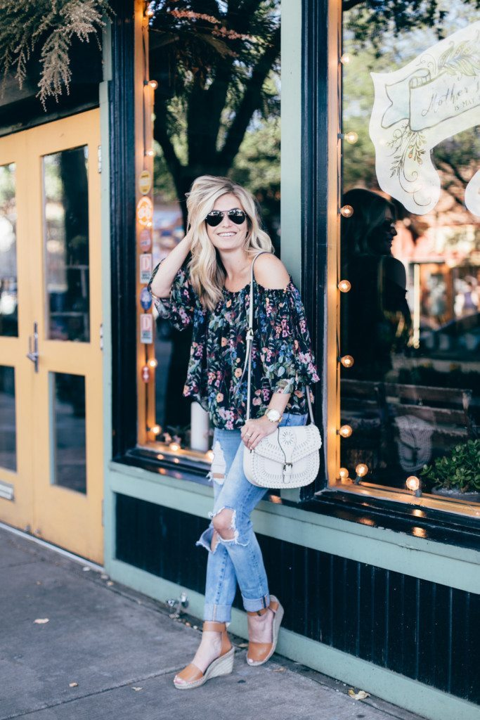 black floral off the shoulder top - ripped jeans - date night outfit