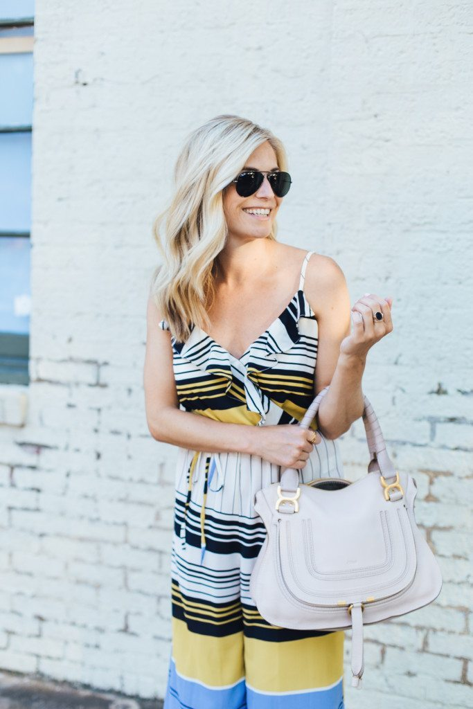 black sunglasses - ruffled jumpsuit - summer dinner outfit