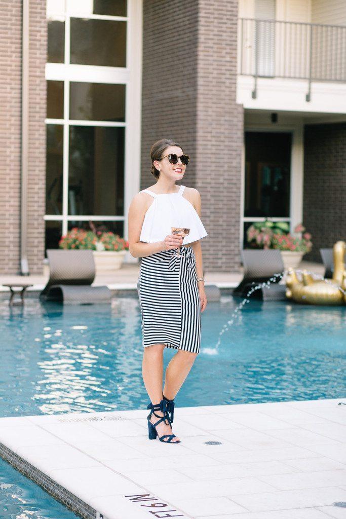 black and white stripe skirt - black heels - white ruffle crop top - summer sunglasses