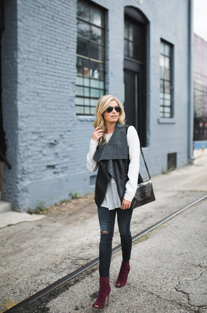 black shearling vest - white ruffle trim top - rag and bone skinny jeans - rebecca minkoff burgundy peep toe booties - dallas fashion blogger