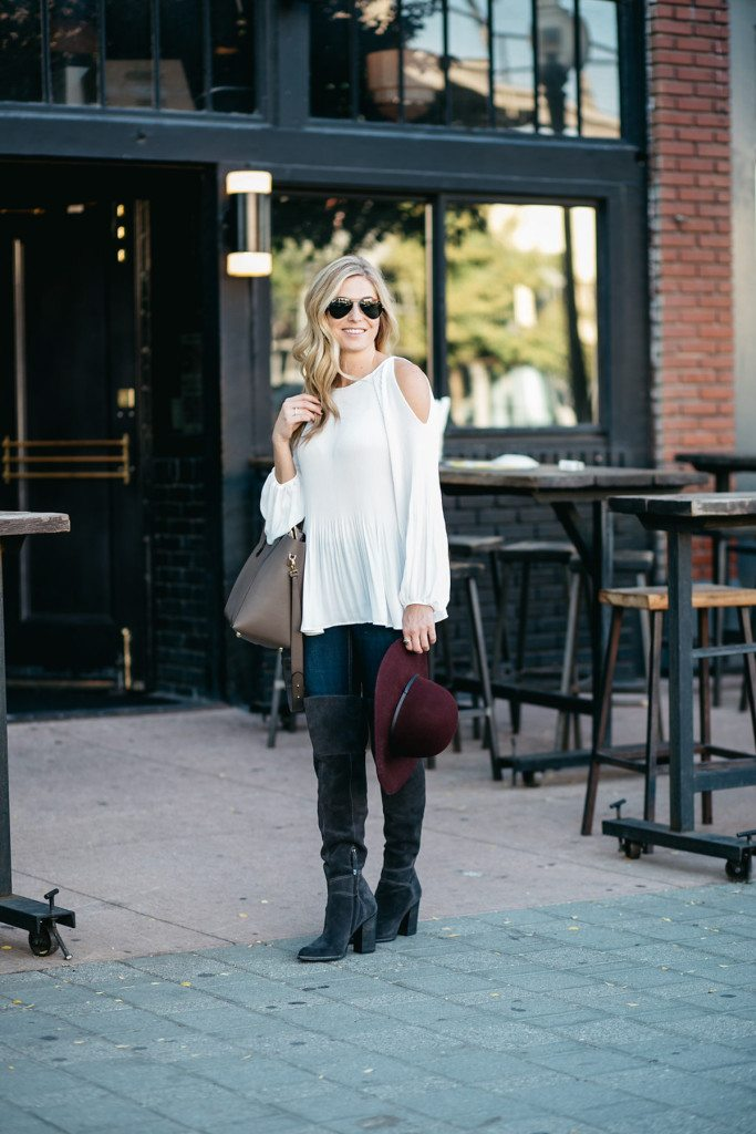 white cold shoulder blouse - rag and bone skinny jeans - burgundy floppy hat - gray over the knee boots