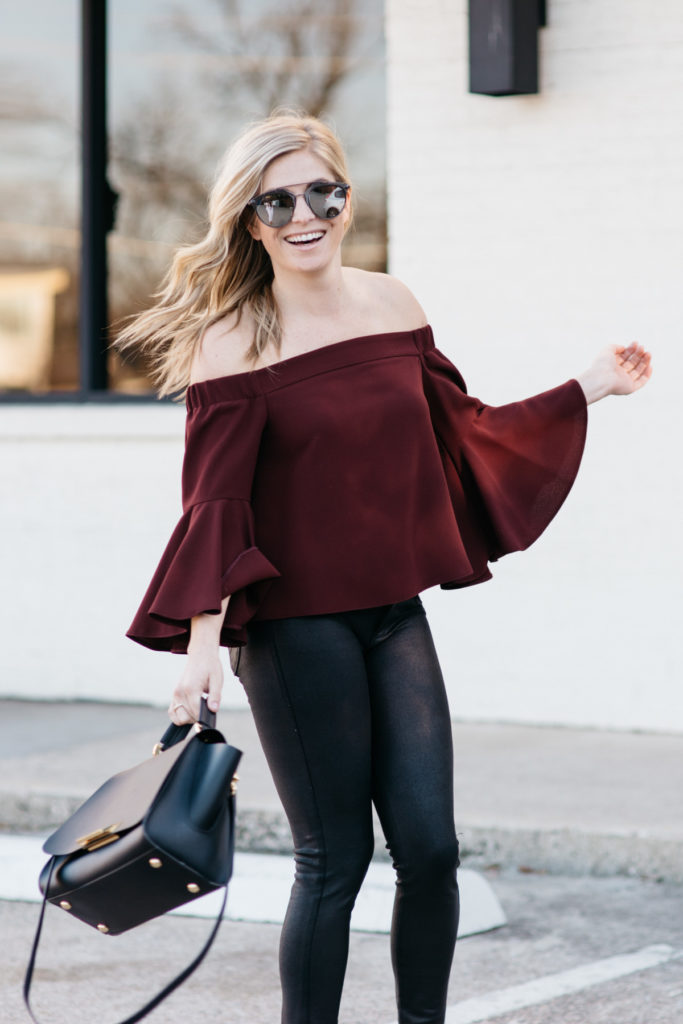 off the shoulder top, black coated skinny jeans, zac zac posen purse, nude patent pumps