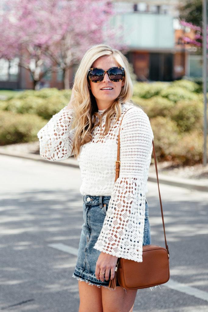 white lace bell sleeve top, jean skirt, gigi new york crossbody