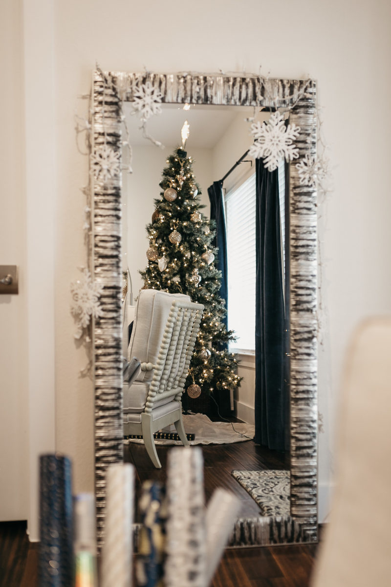 living room mirror with christmas tree reflection