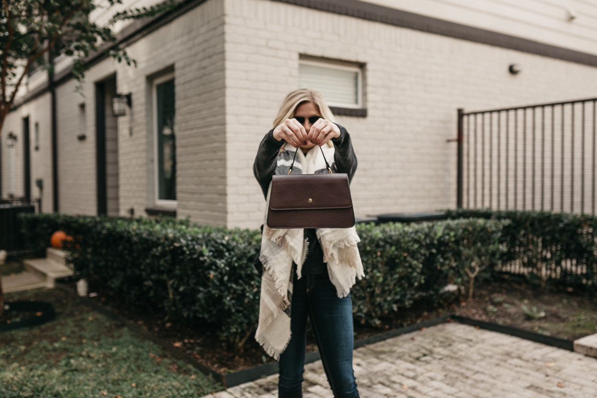 woman holding a bag up