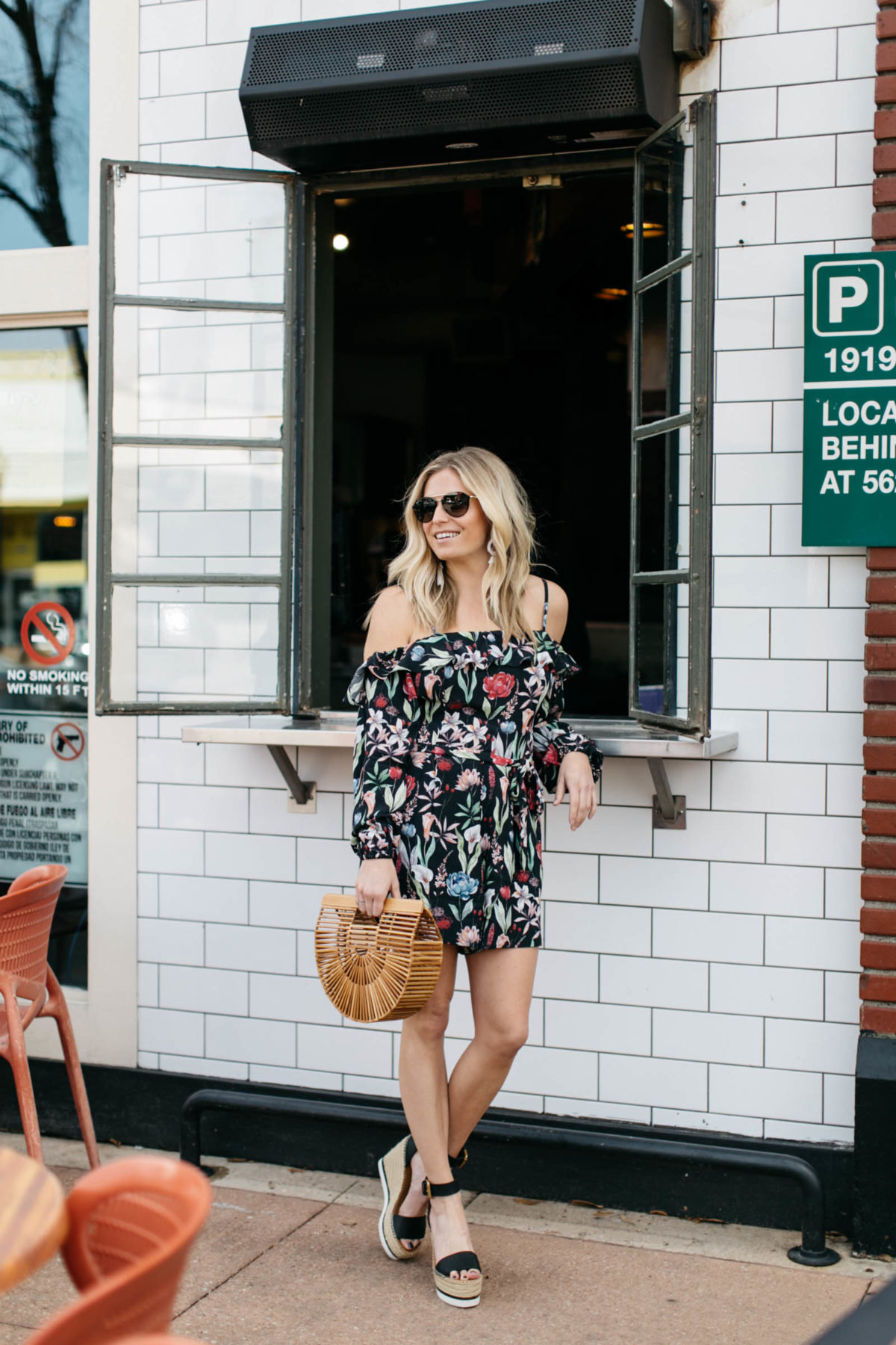 One Small Blonde is featuring a floral dress and a weave bag