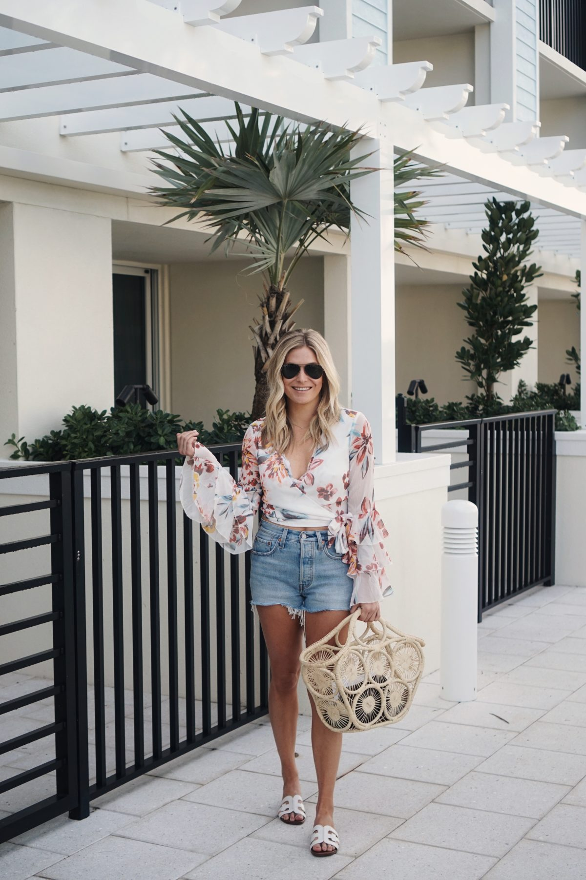denim shorts paired with floral crop top - Florida Beach Outfits