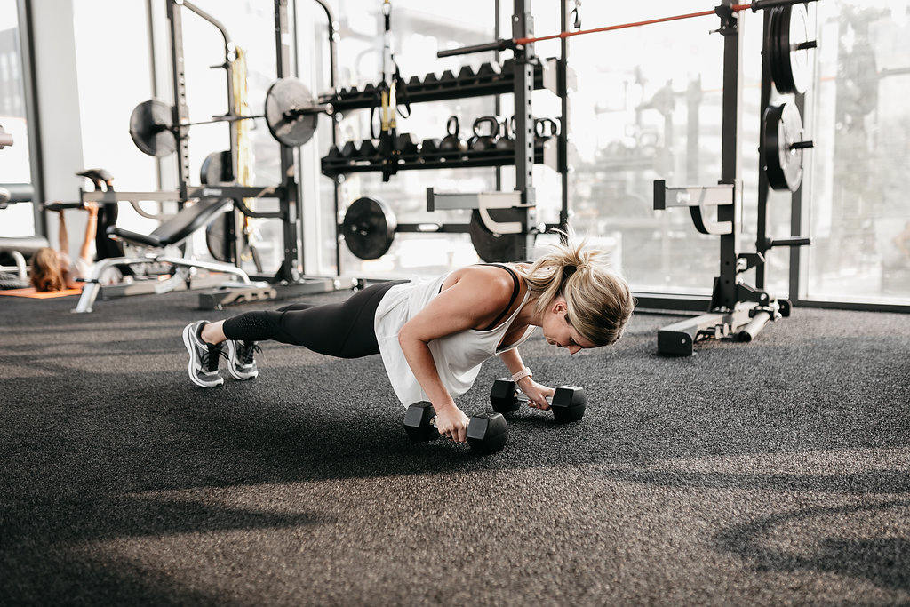 woman doing elevated pushups for exercises for toned arms