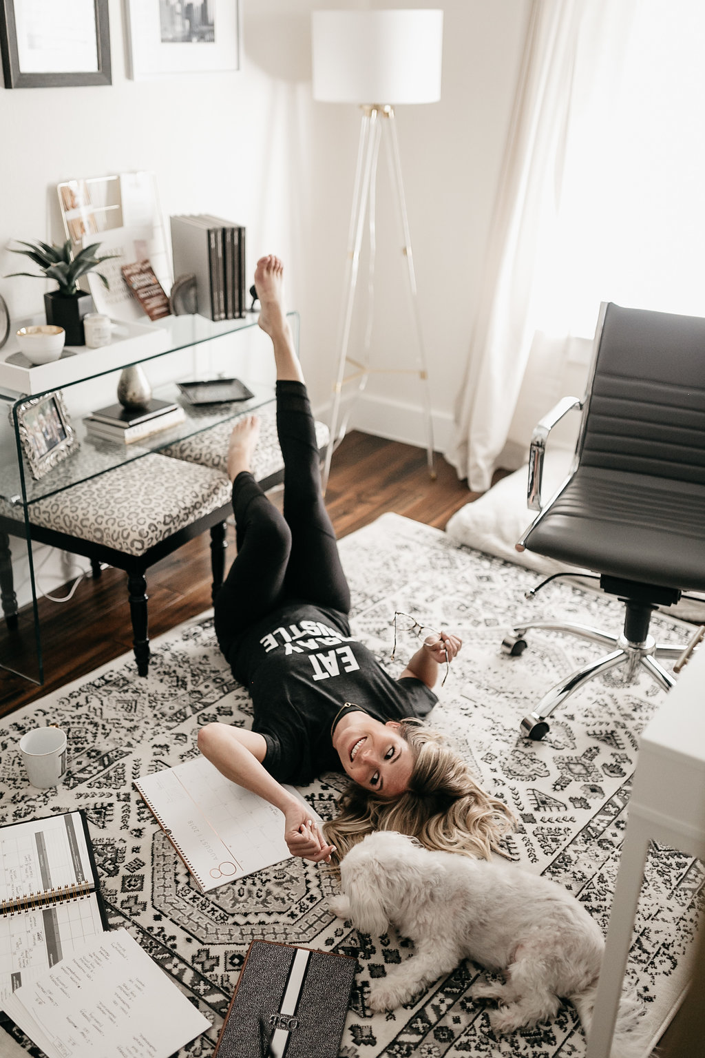 woman laying down on the floor of her home office