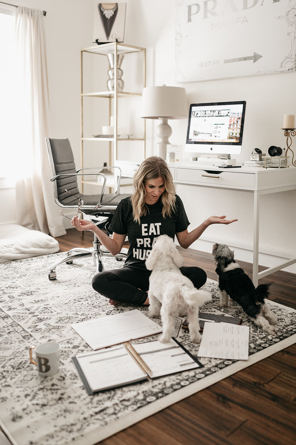woman playing with her two dogs in her home office for ADVICE ON FULL-TIME BLOGGING