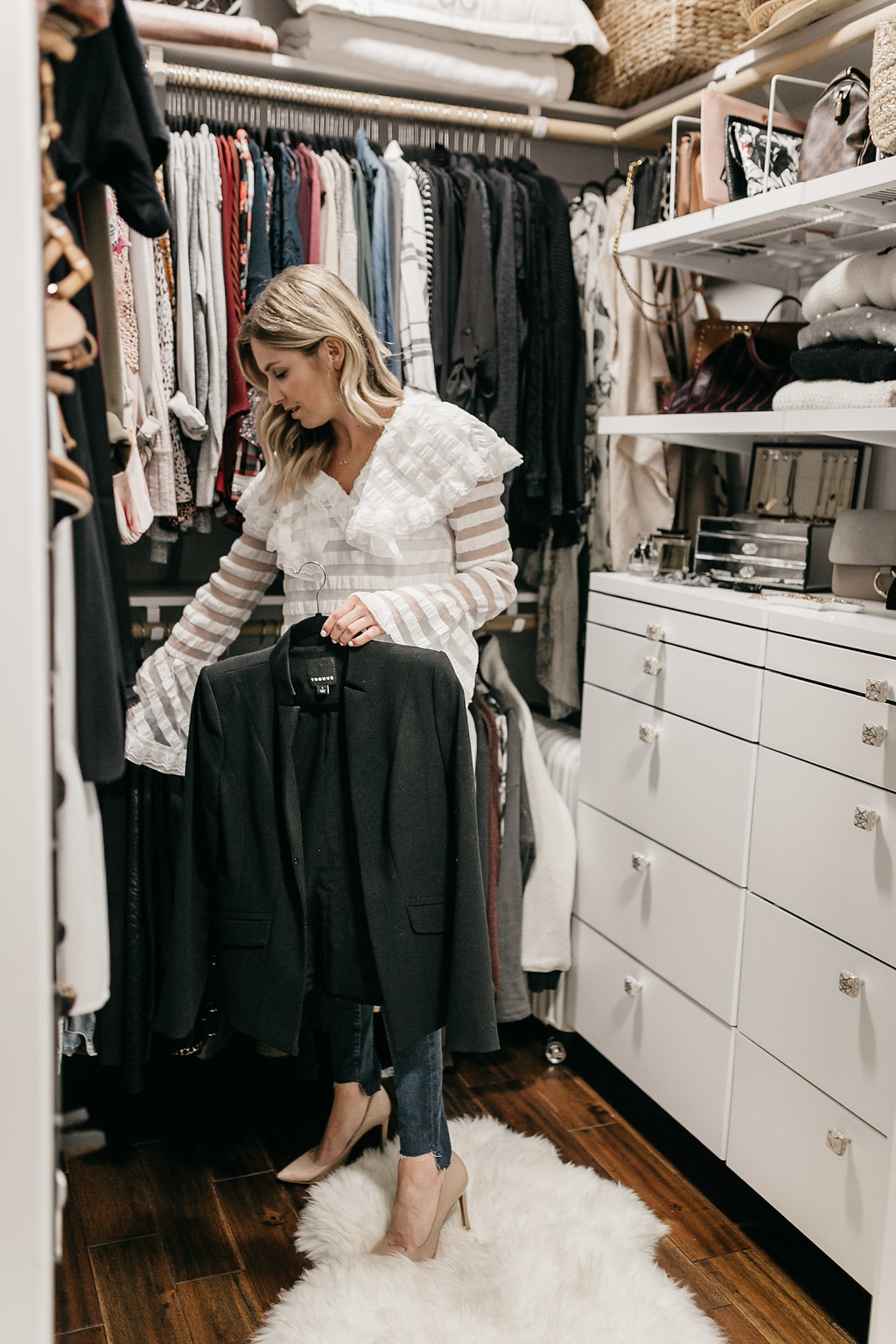 CLOSET ORGANIZATION REVEAL with woman holding jacket