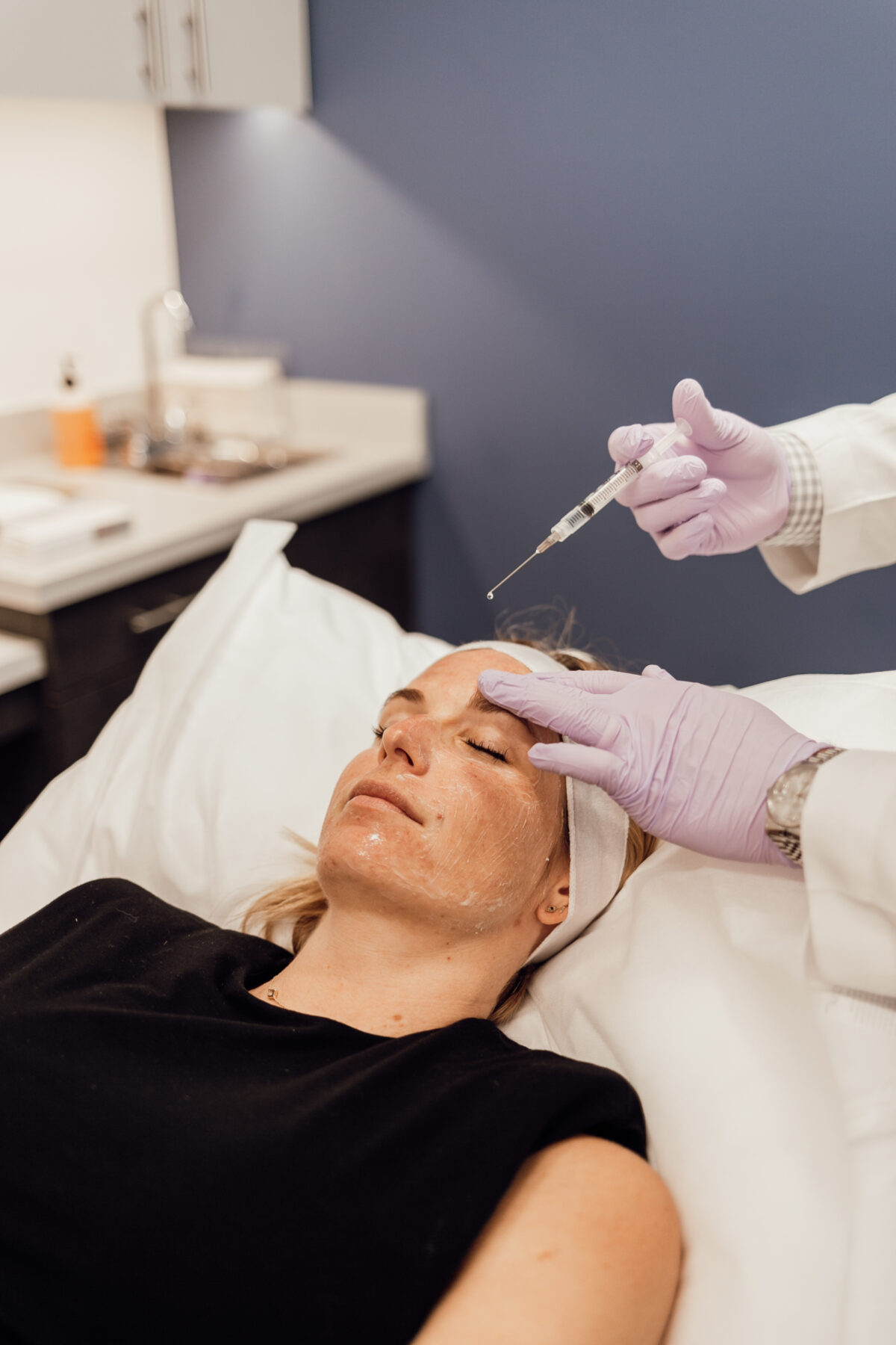 woman getting an injection on the face for Melasma Treatment