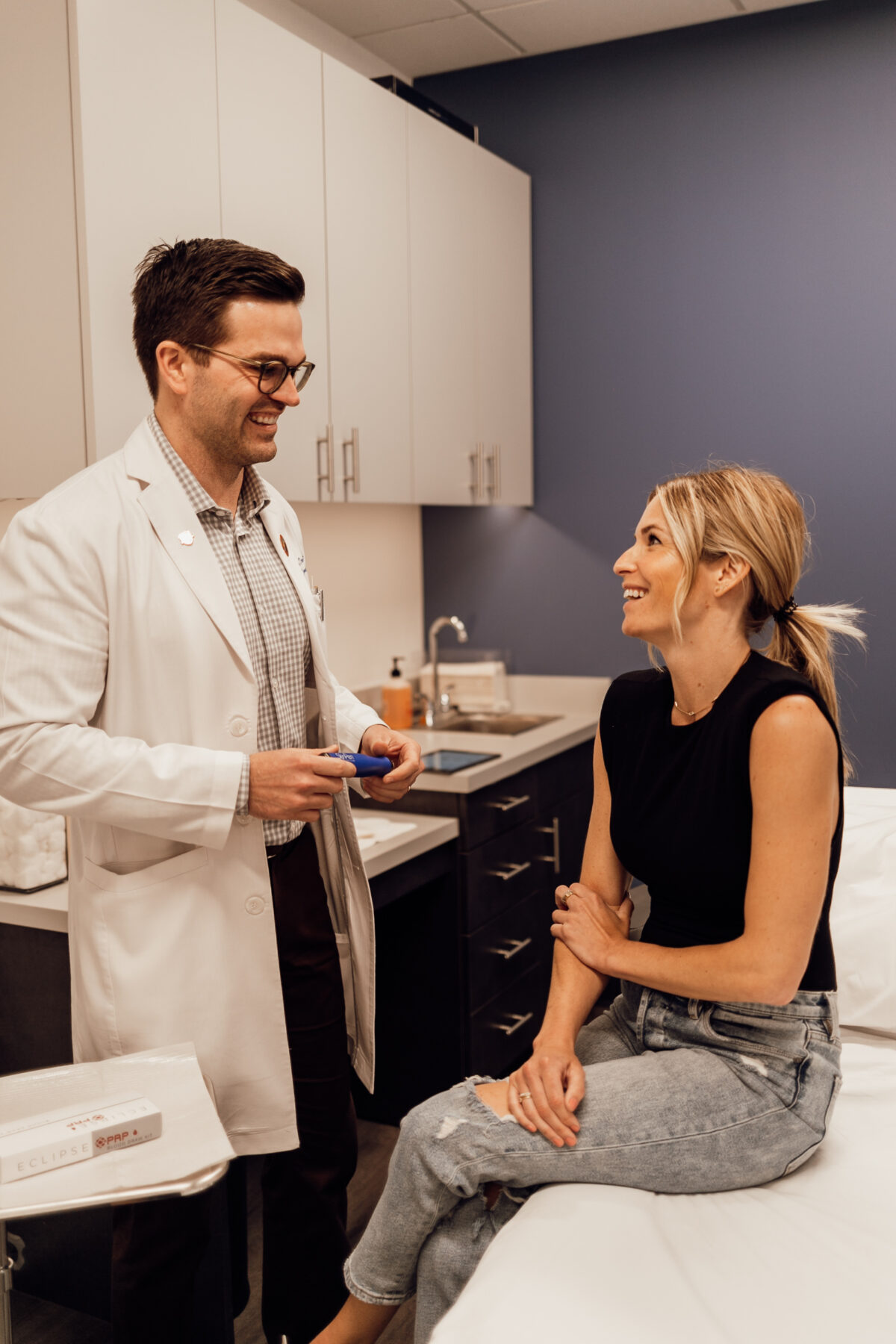 woman in the clinic talking to her physician about Melasma Treatment