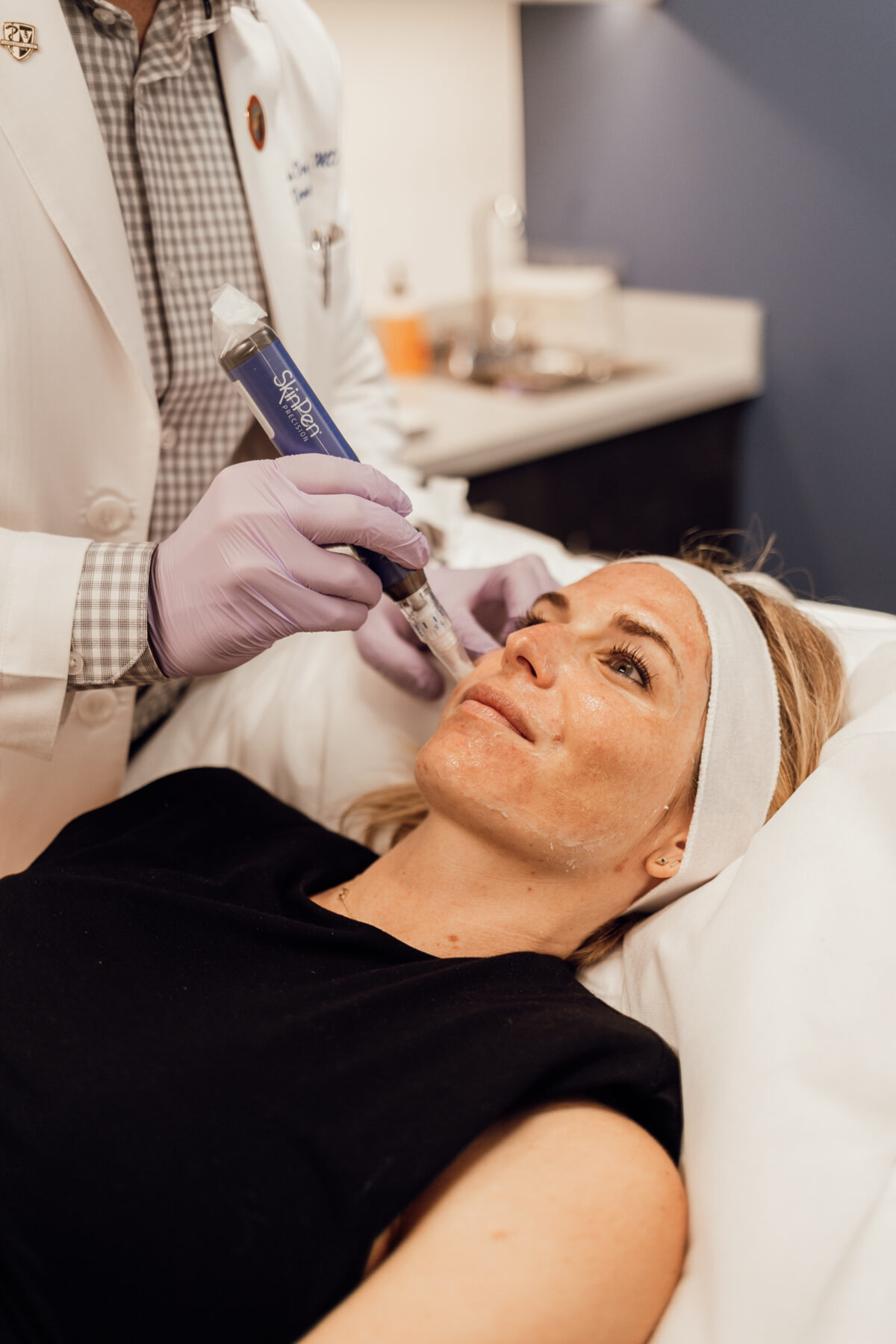 woman's face getting treated