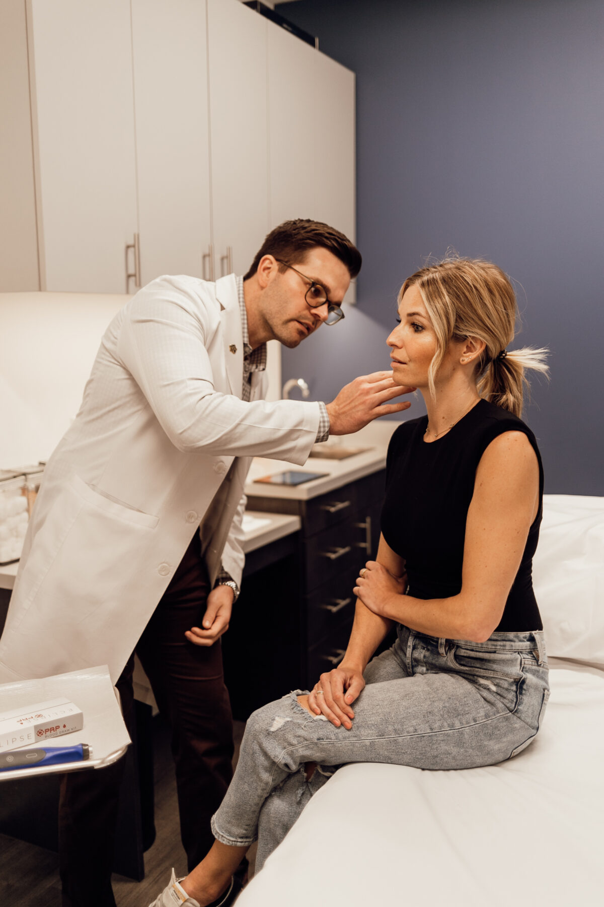 a dermatologist checking the face and skin of a woman for Melasma Treatment